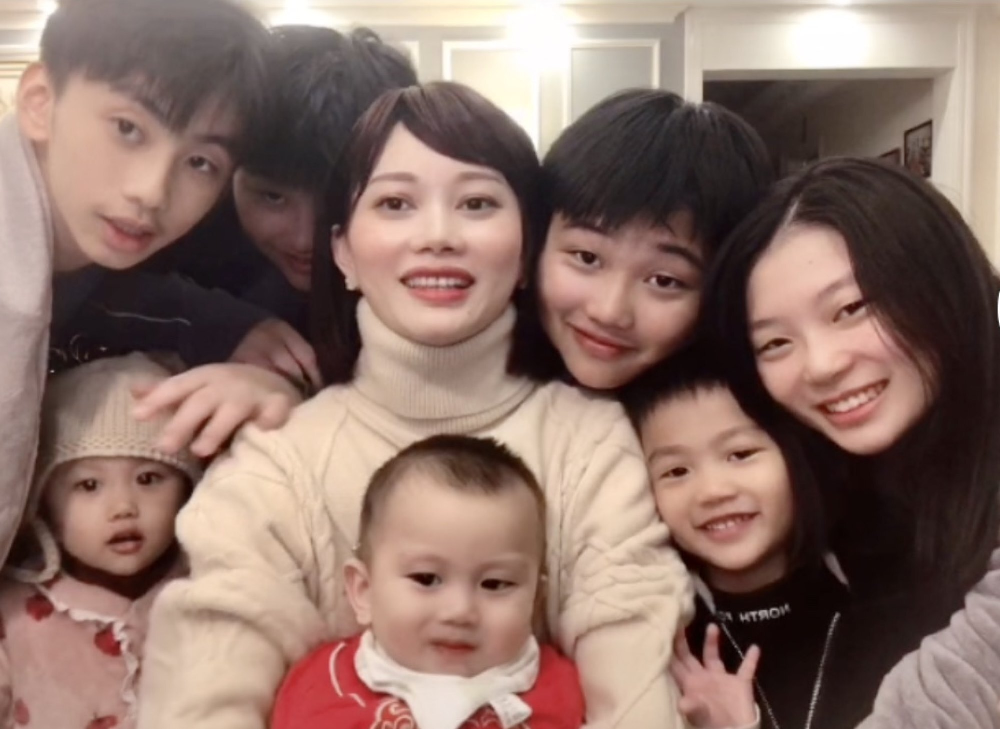 Zhang with her children. Photo: Zhang Rongrong