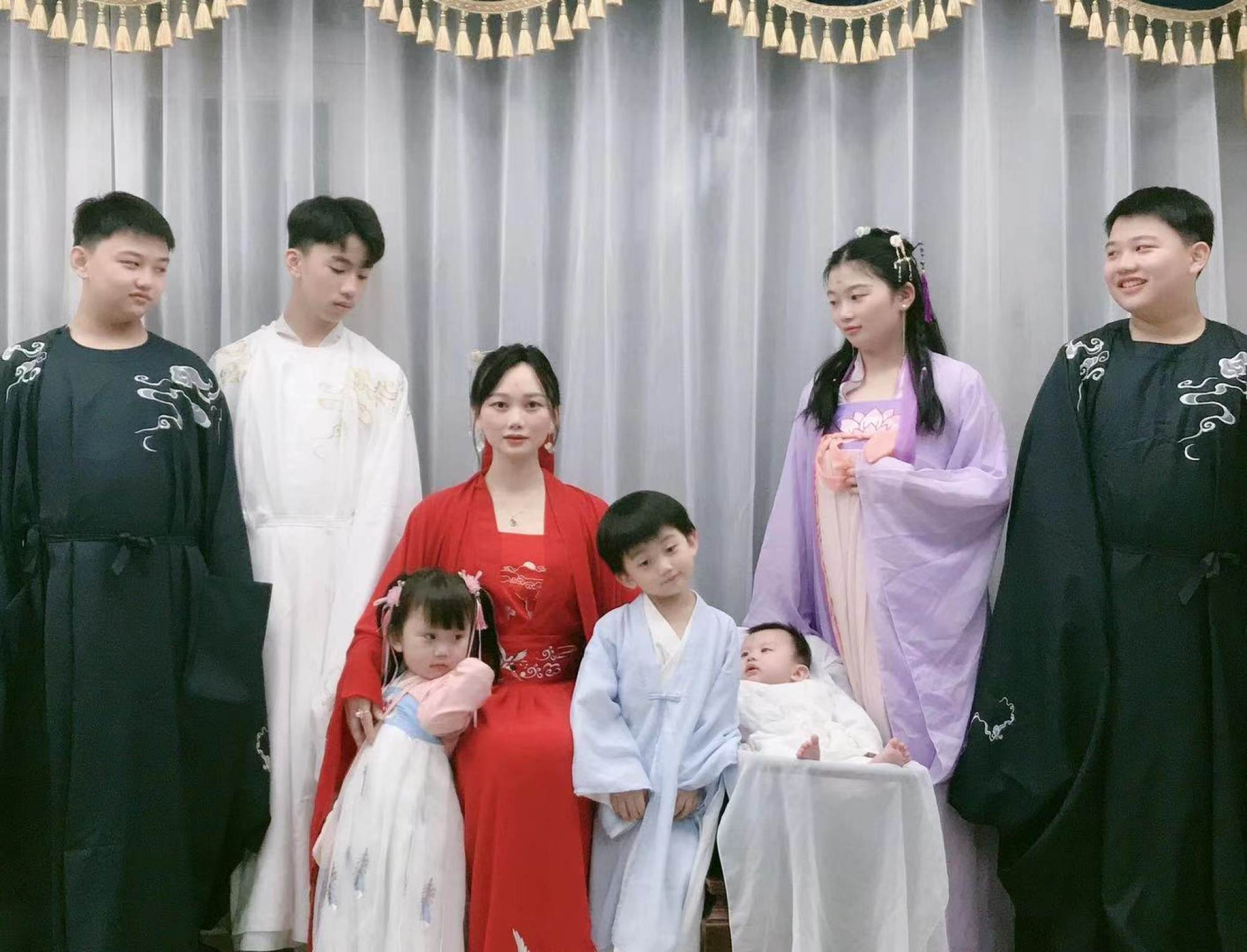 Zhang (in red) with her children. Photo: Zhang Rongrong