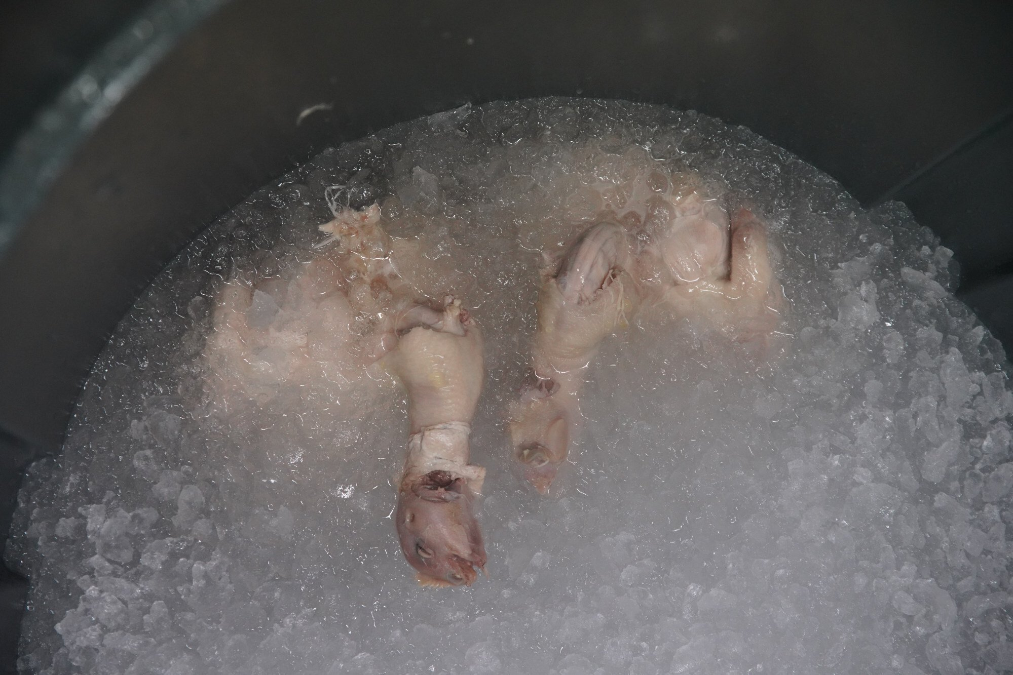 After being poached, the chicken gets an ice bath. This forms the jelly between the skin and the meat. Photo: Winson Wong