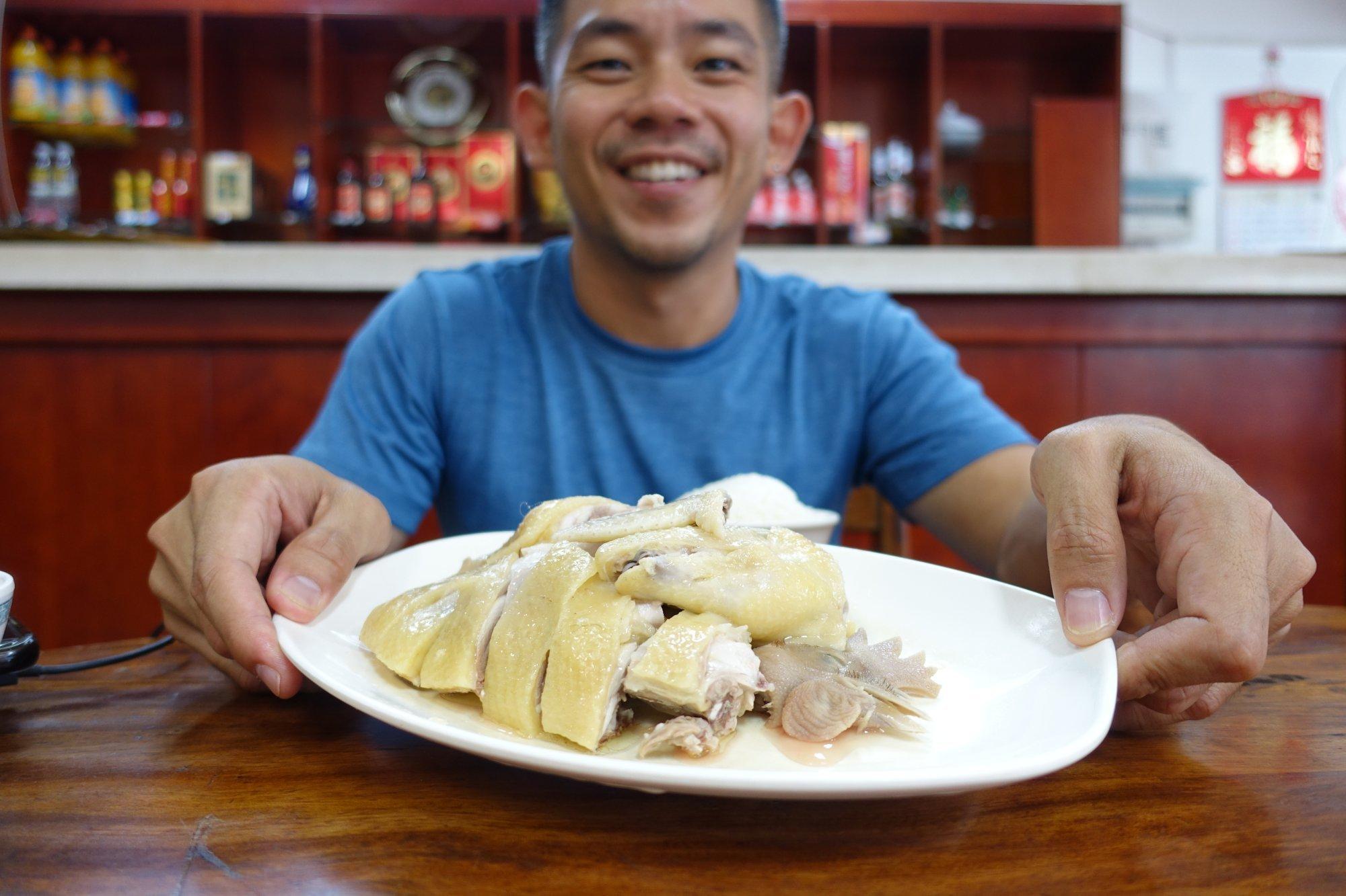 Bryan Wong with a plate of Wenchang chicken in Wenchang, Hainan, China. Photo: Bryan Wong
