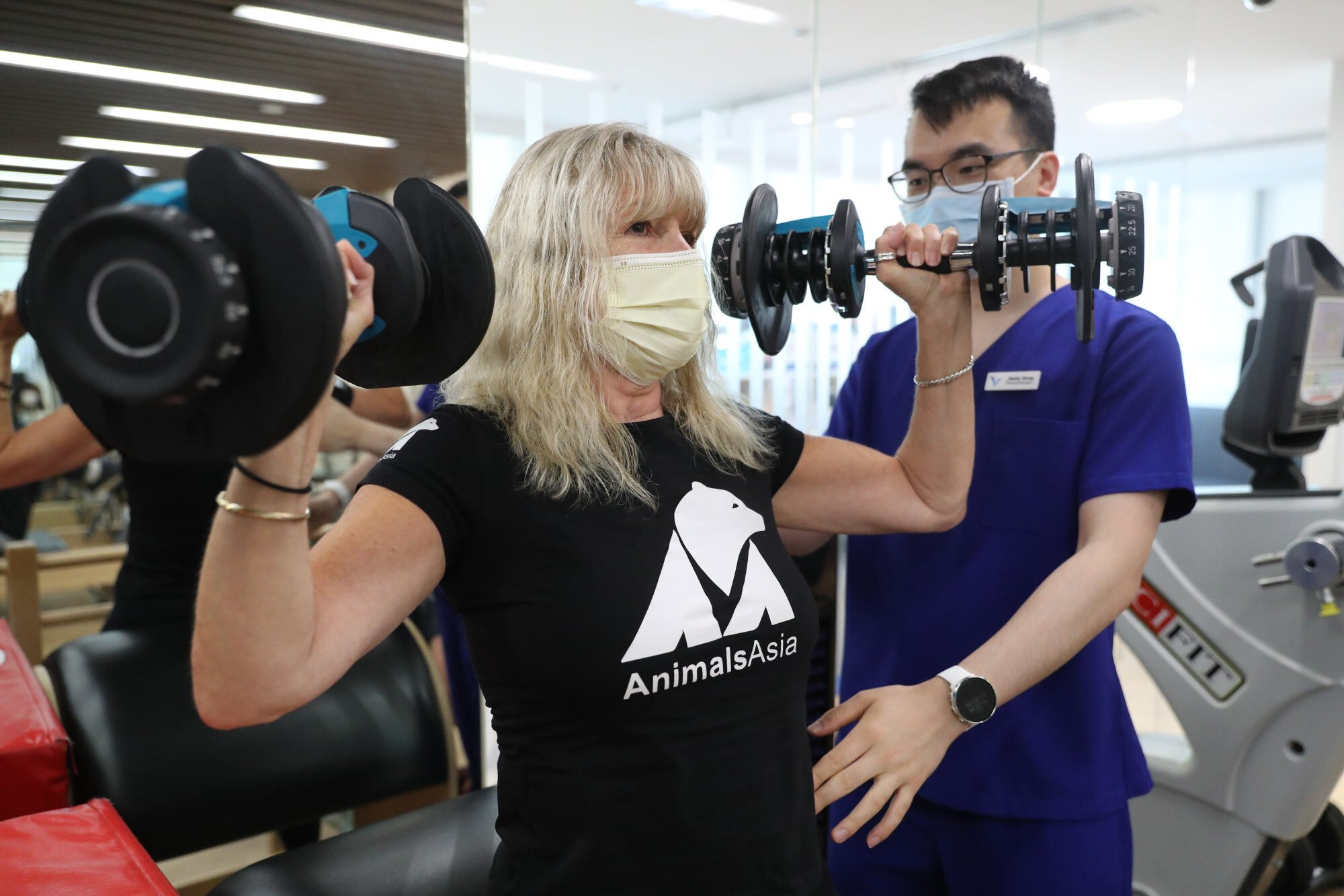 Robinson undergoes a therapy session with her physiotherapist Wong Man-ho at Virtus, a gym in Hong Kong's Central district. Photo: Edmond So