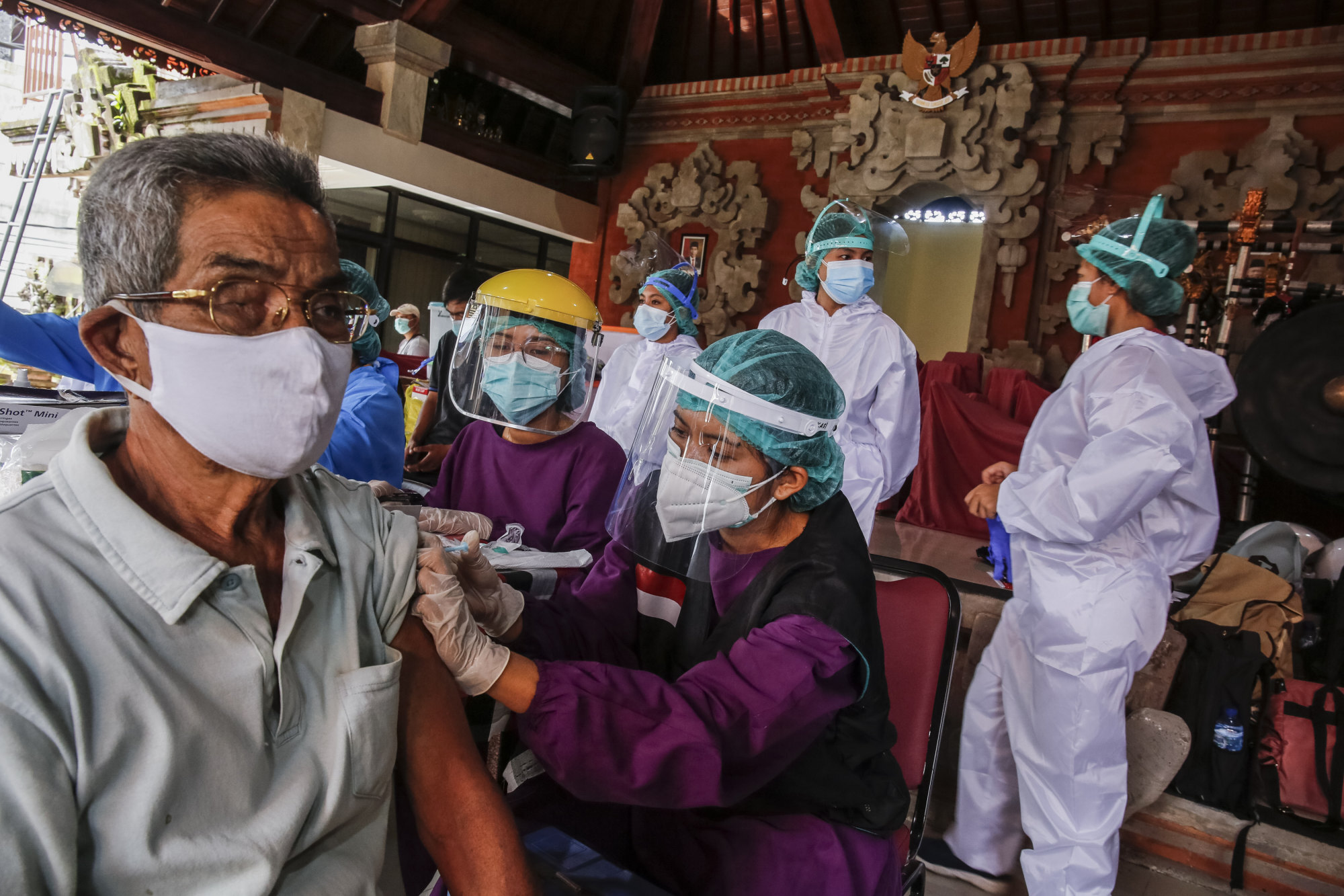 A health worker is vaccinated against Covid-19 in Denpasar, on March 22. Photo: Getty Images