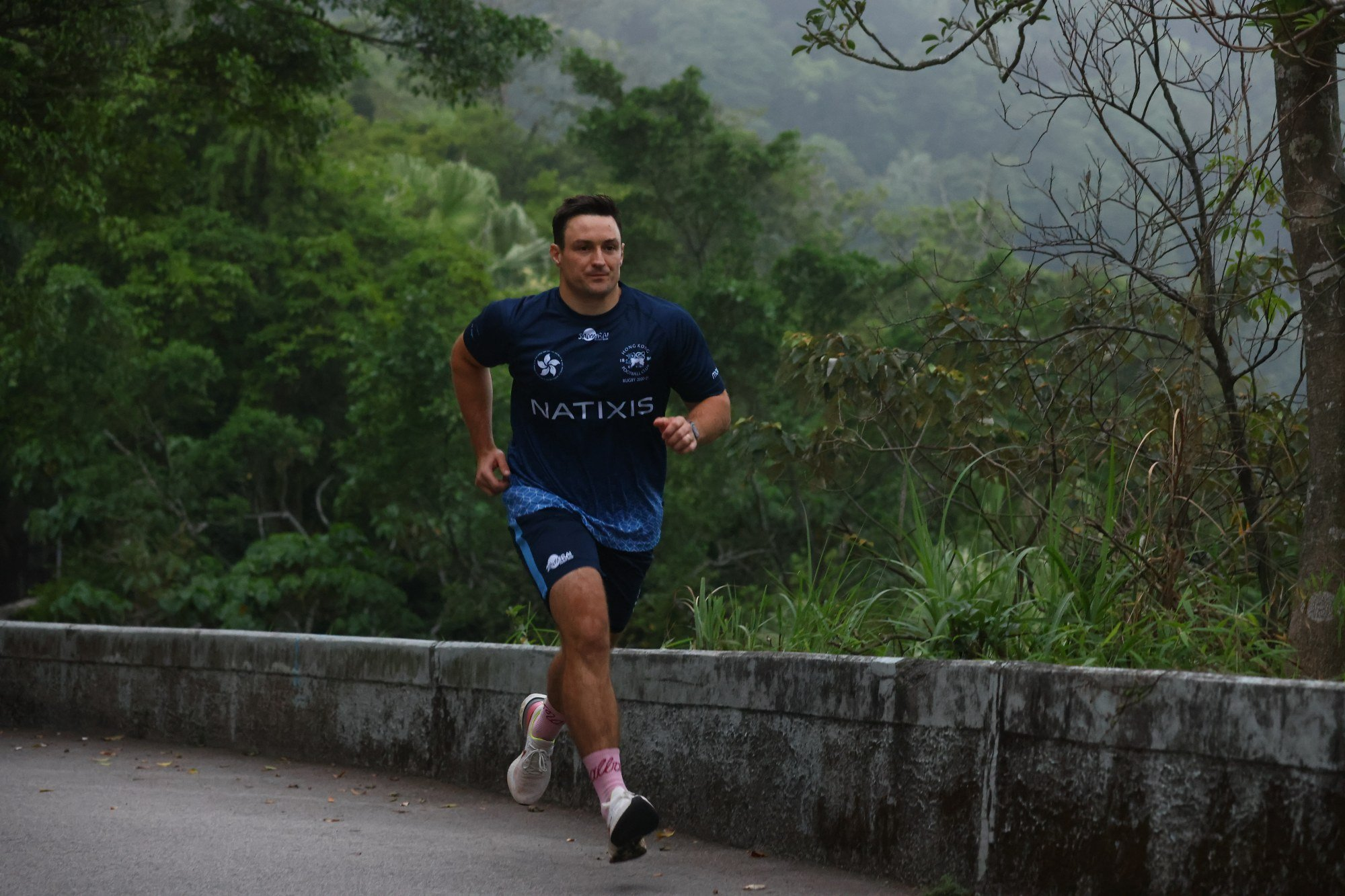 John McCormick-Houston runs up Magazine Gap in Mid-Levels as part of the 'HKFC Rugby to Hanoi' fundraising month. Photo: Dickson Lee