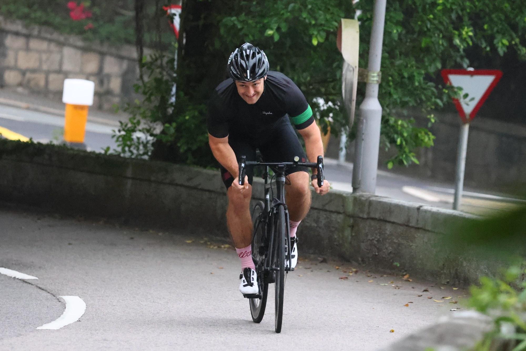 John McCormick-Houston riding his bike to raise money for the programme. Photo: Dickson Lee