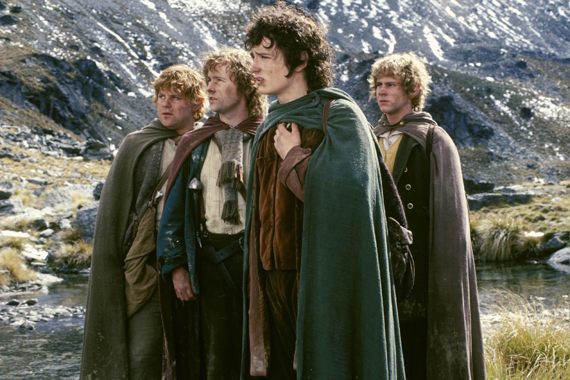 Actors, from left, Dominic Monaghan, Elijah Wood, Billy Boyd and Sean Astin, appear in a scene from the fantasy epic The Lord of the Rings. Photo: Handout