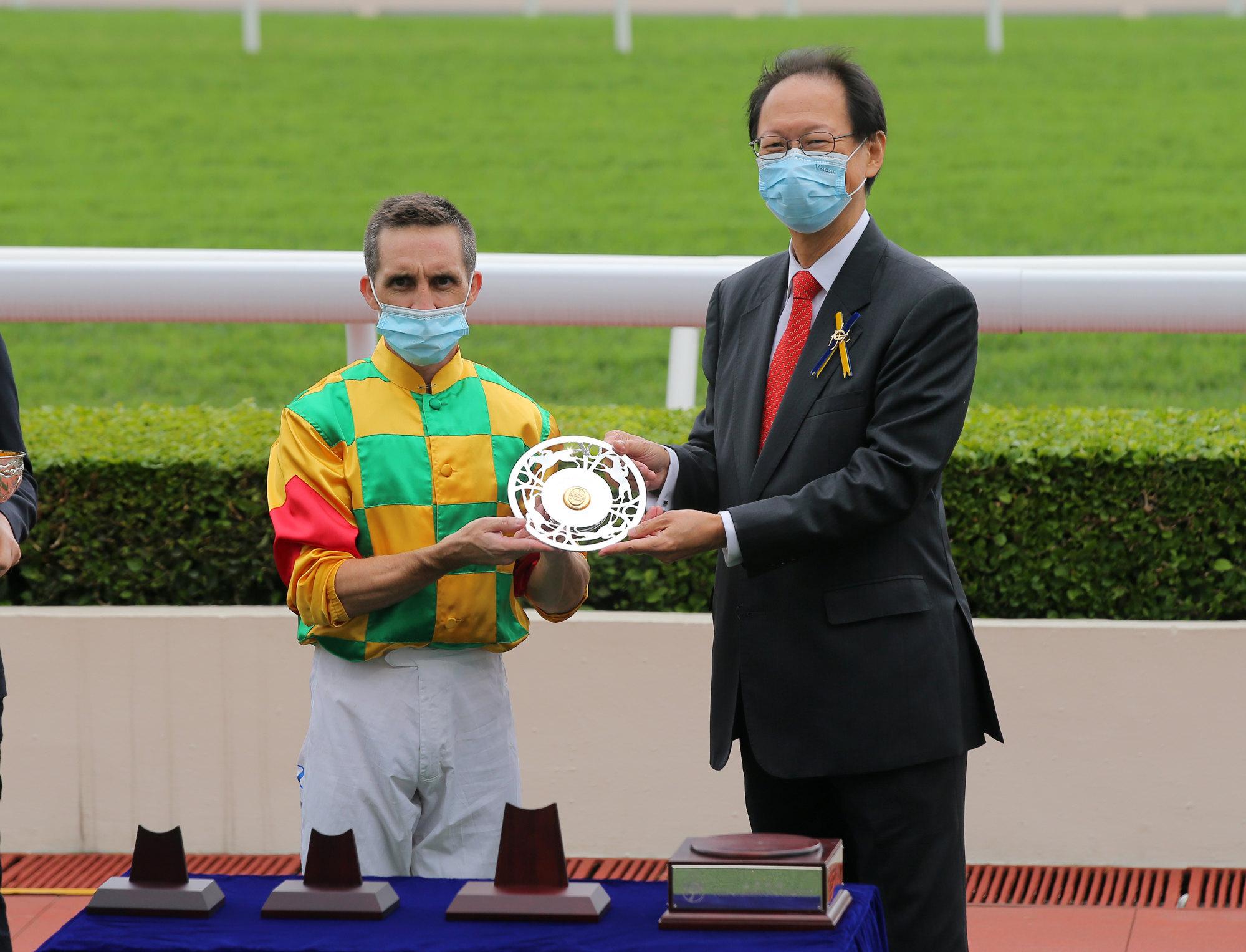 Neil Callan and Jockey Club chairman Philip Chen.
