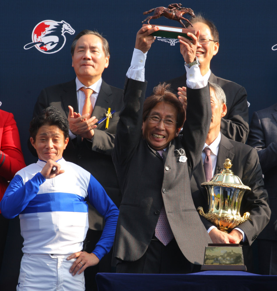 Takayuki Yasuda celebrates Lord Kanaloa's 2013 Hong Kong Sprint victory.