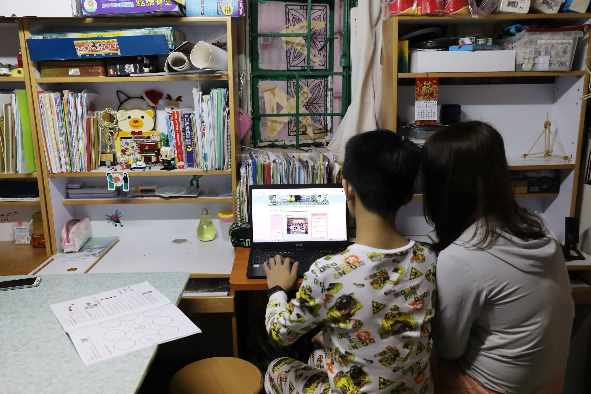 A disadvantaged student studies in a Sham Shui Po home. The pandemic has made the disparities between children from low-income and wealthy families more apparent than ever. Photo: K.Y. Cheng