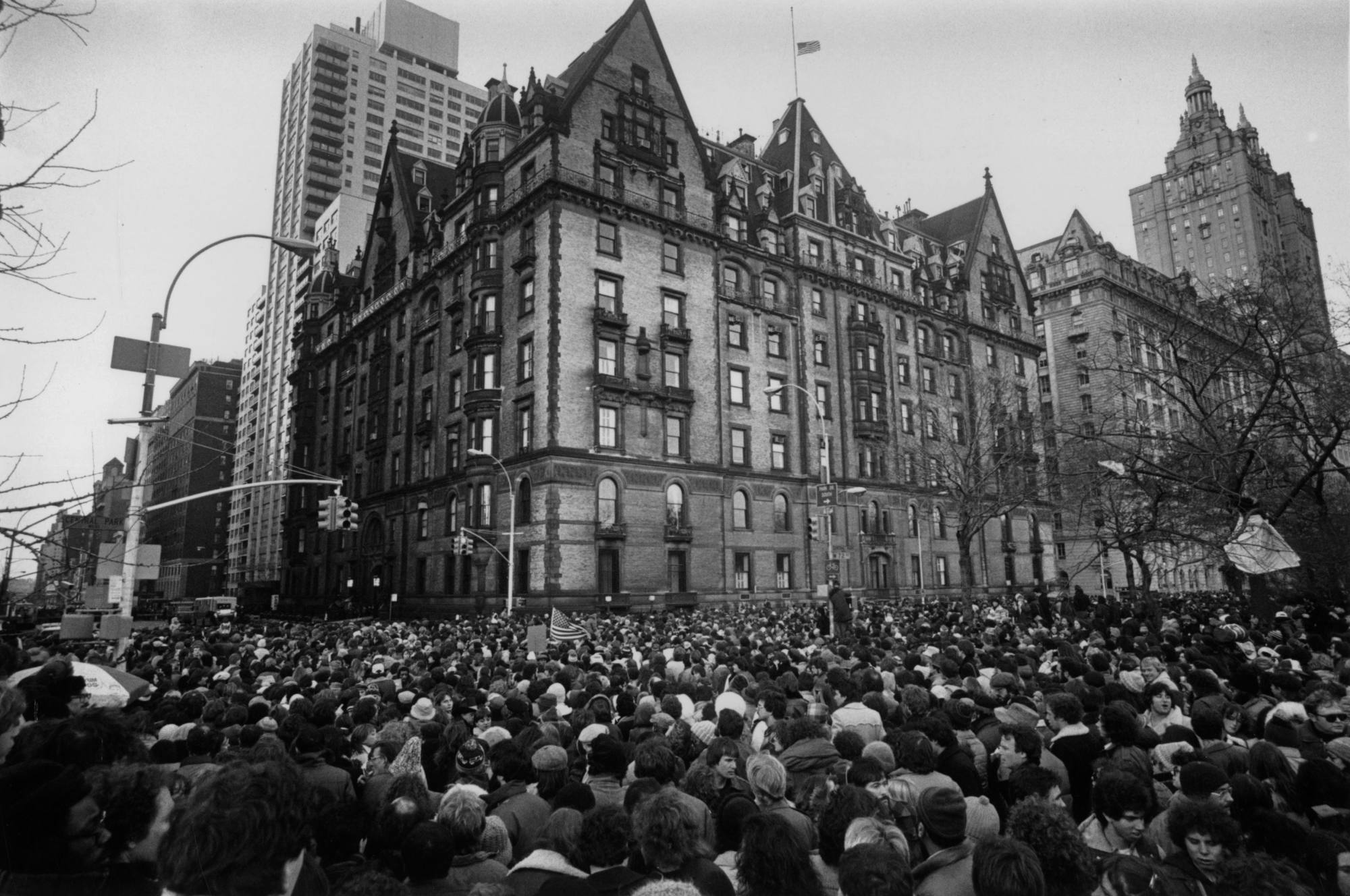 Crowds gather outside the home of John Lennon in New York in December, 1980, after the news that he had been shot and killed. Photo: Getty Images