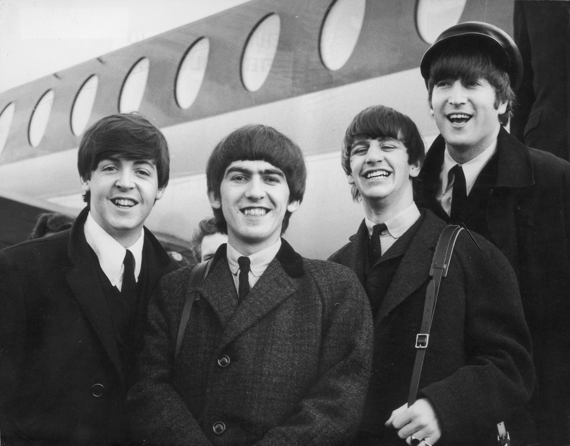 The Beatles (from left) Paul McCartney, George Harrison, Ringo Starr and Lennon arrive in London in February, 1964, after a trip to Paris. Photo: Getty Images