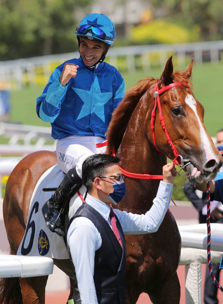 Joao Moreira and Frankie Lor celebrate Master Eight's victory.