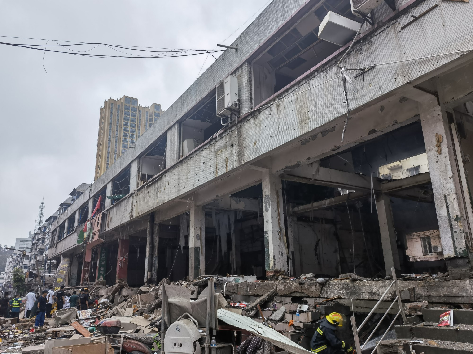 Rescuers search the rubble after the blast. Photo: Xinhua