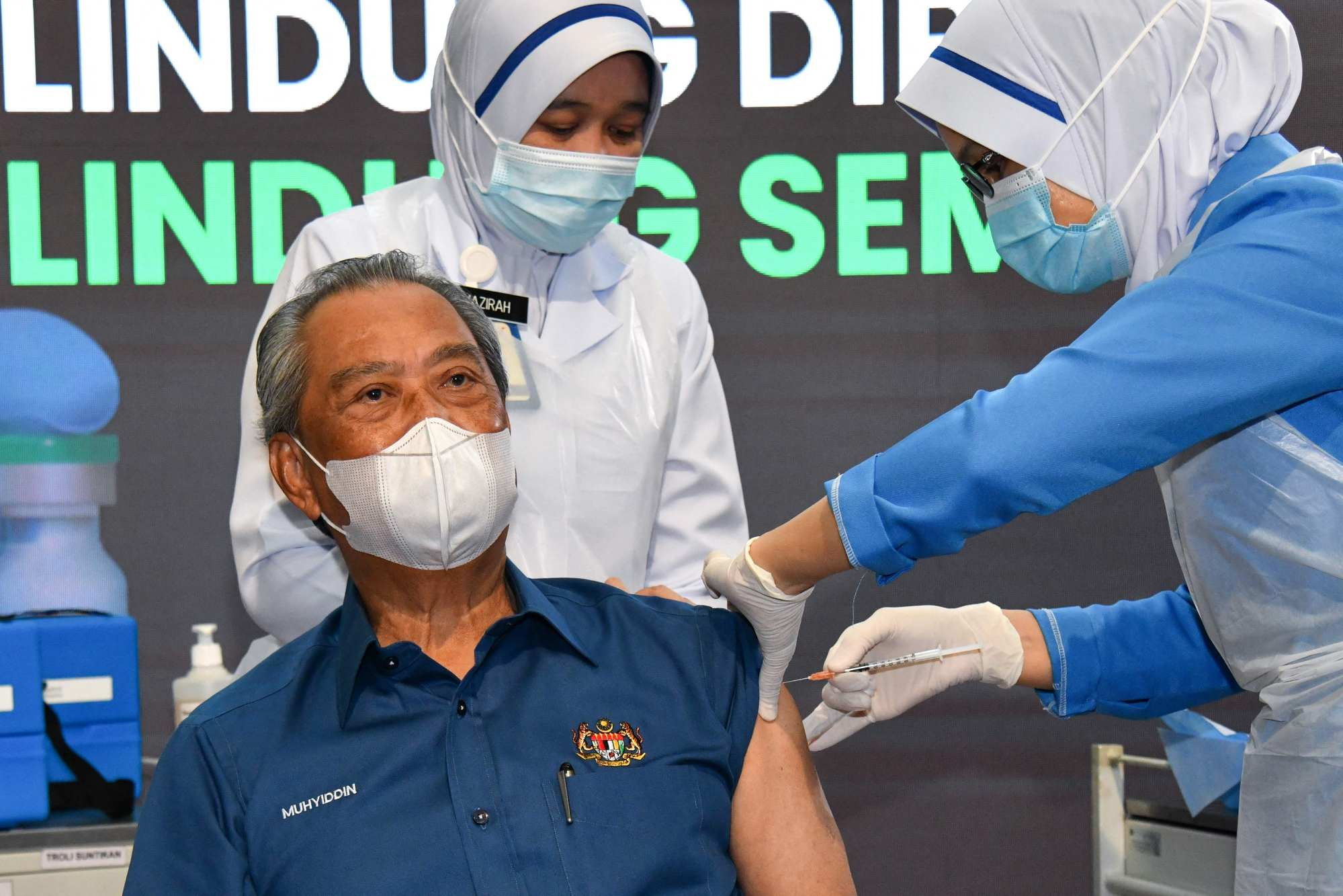 Malaysian Prime Minister Muhyiddin Yassin receives the first dose of the Pfizer Covid-19 vaccine at a government clinic in Putrajaya. Photo: AFP