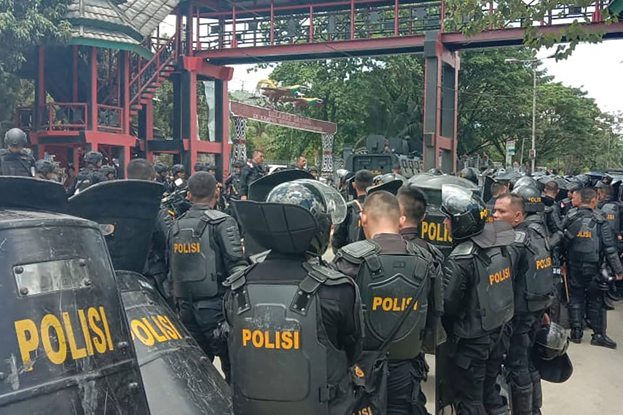 Indonesian riot police take positions at a university in the provincial capital Jayapura during protests in 2019. Photo: AFP