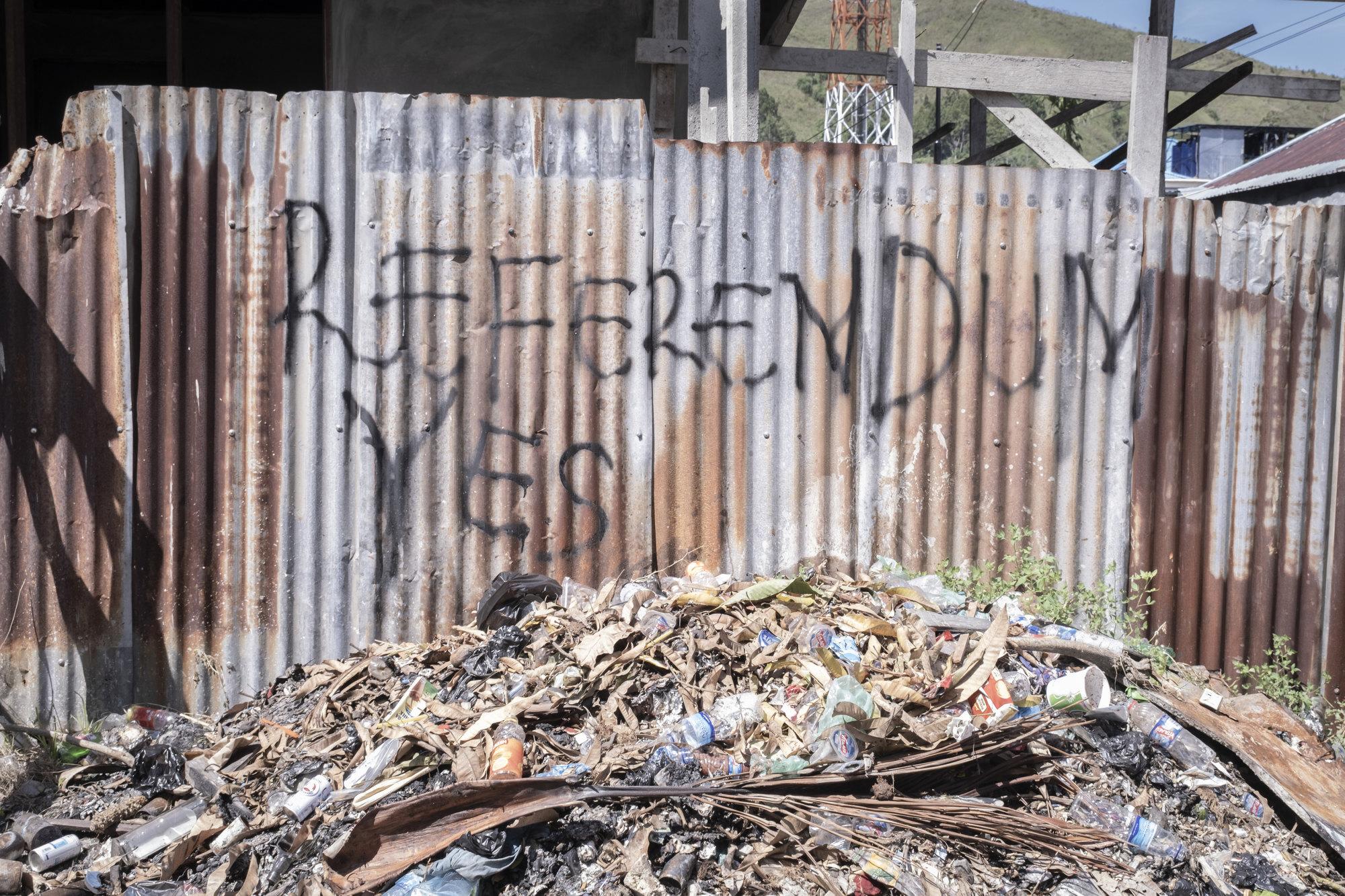 Graffiti calling for a referendum on Papuan self-rule in a residential area in Waena, Jayapura, Papua. Photo: Albertus Vembrianto