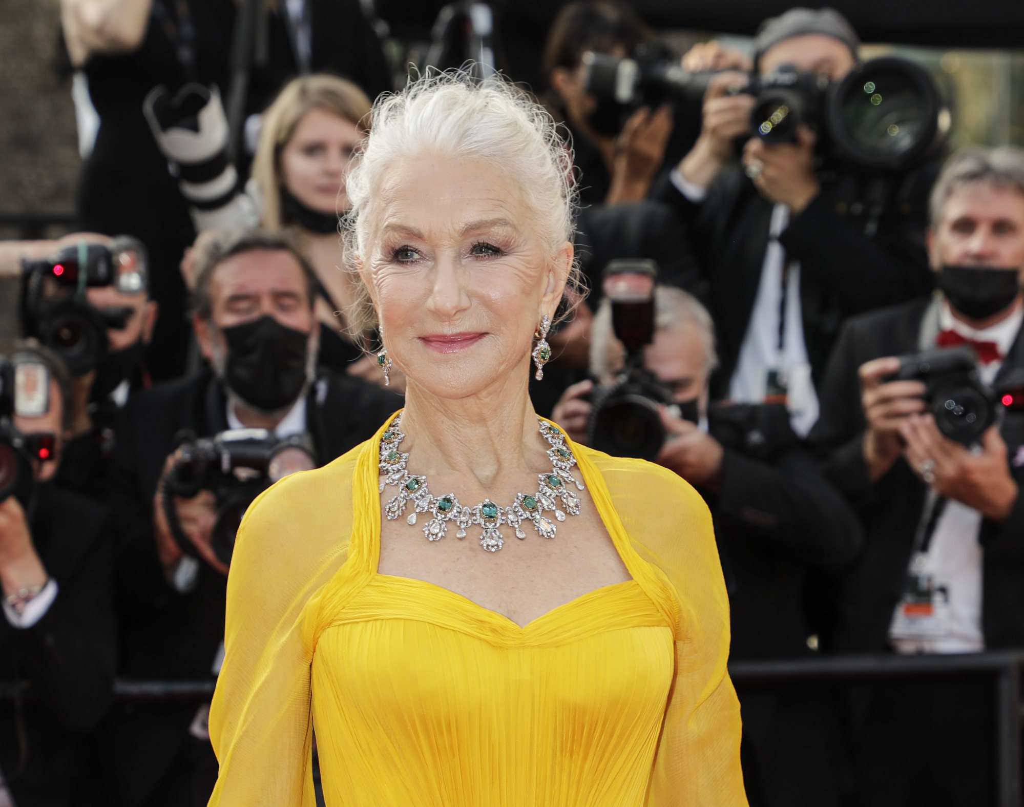 Helen Mirren poses for photographers upon arrival at the premiere of the film Annette and the opening ceremony of the 74th international film festival in Cannes, France on July 6, 2021. Photo: Invision/AP