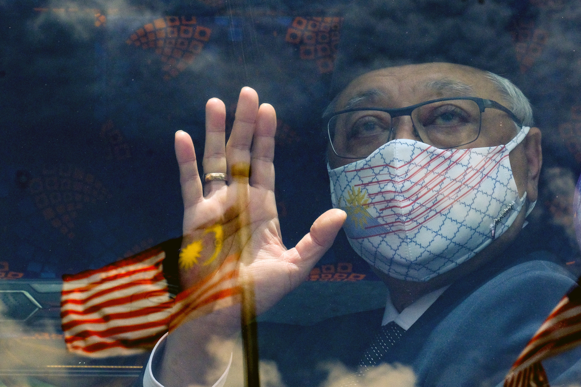 Malaysia's new Prime Minister Ismail Sabri Yaakob waves from a bus. Photo: Bloomberg