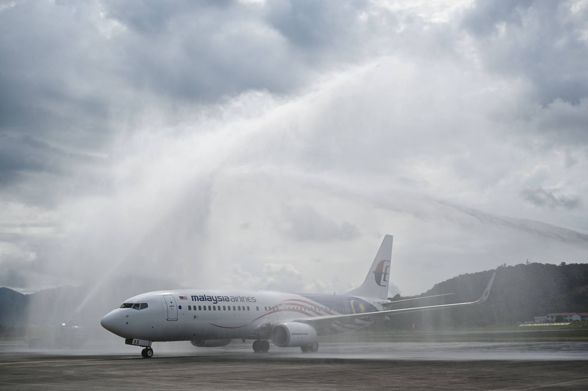 A water salute welcomes the first Malaysia Airlines aircraft to touch down in Langkawi from Kuala Lumpur on September 16 after the opening of a travel bubble for domestic visitors. Photo: AFP