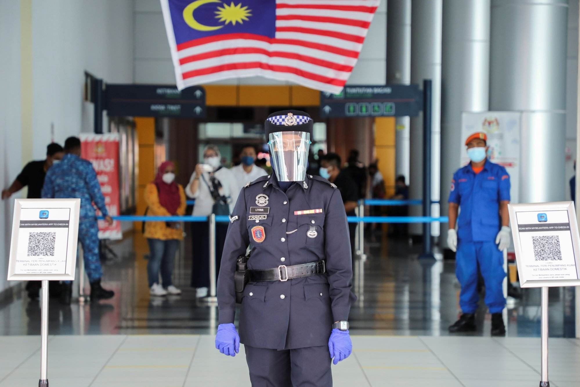 A police officer waits for arriving tourists in Langkawi. Photo: Reuters
