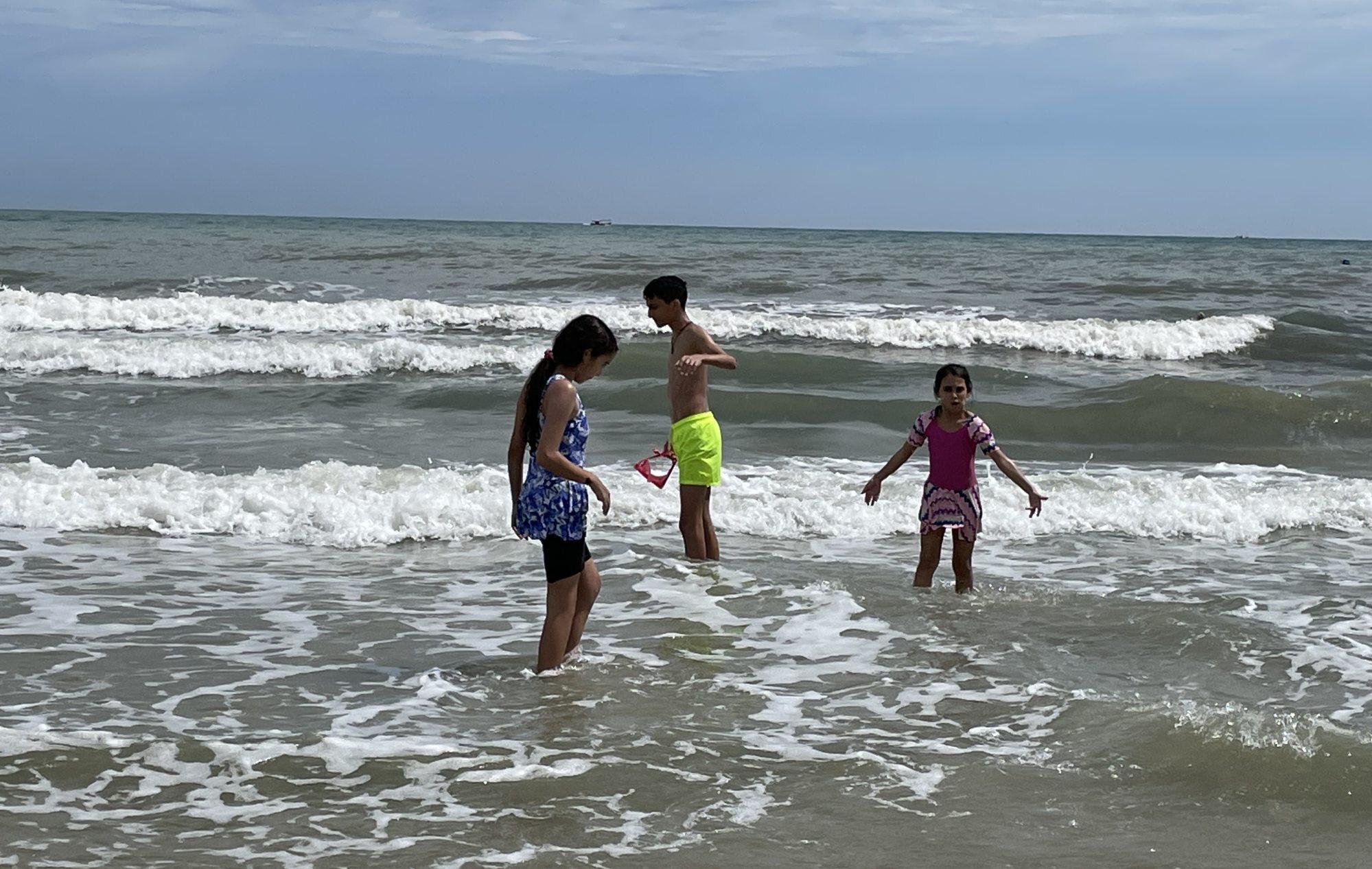 Yaseen, Sanna and Ammal El Muzayen have fun on the beach in Langkawi, Malaysia. Photo: Ziad El Muzayen