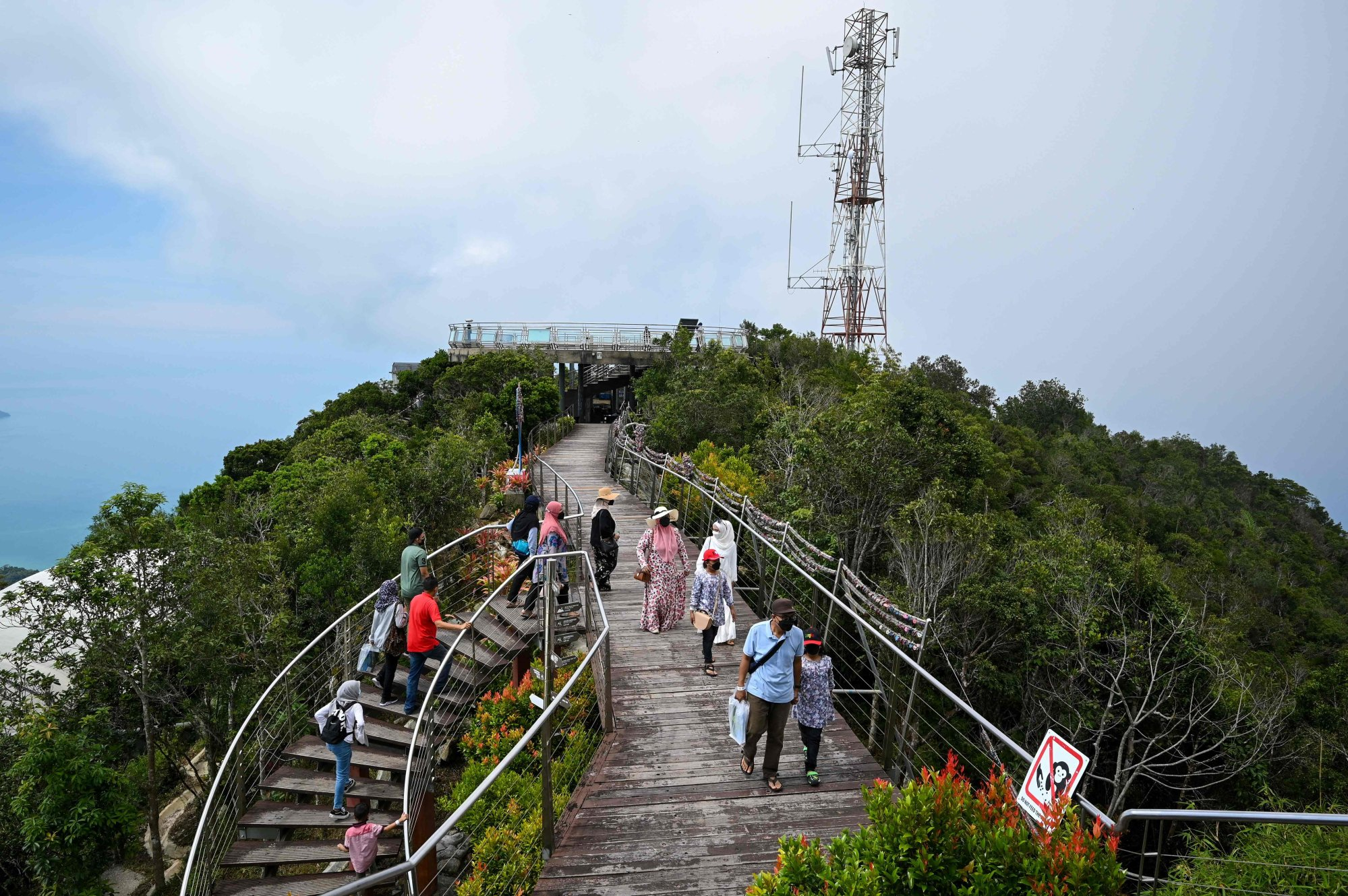 Visitors walk around a lookout point near a Langkawi Skycab cable car station. Photo: AFP