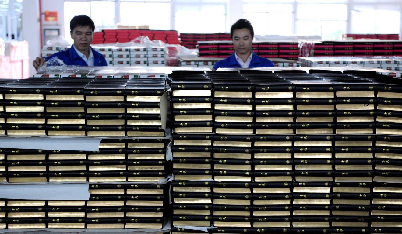 Print shop workers in Nanjing, Jiangsu province, prepare Bibles for distribution. Photo: Xinhua