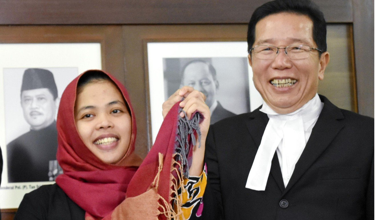 Siti Aisyah from Indonesia smiles following her release from detention on Monday. Photo: Kyodo