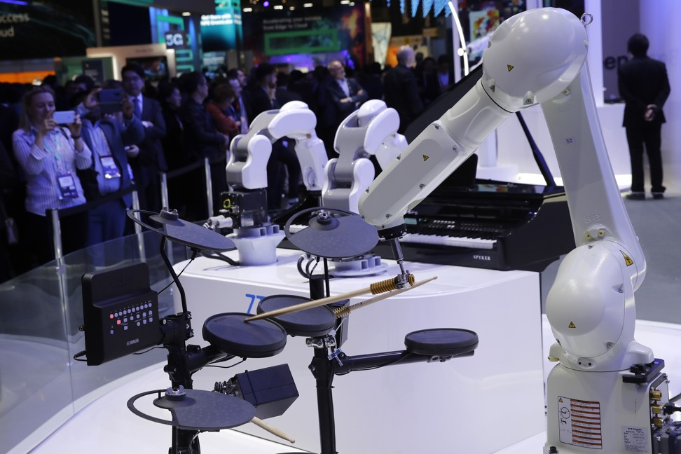 A 5G controlled robotic arm plays a drum kit as part of a smart connected band at the ZTE stand at a wireless industry conference in Barcelona. Photo: Bloomberg