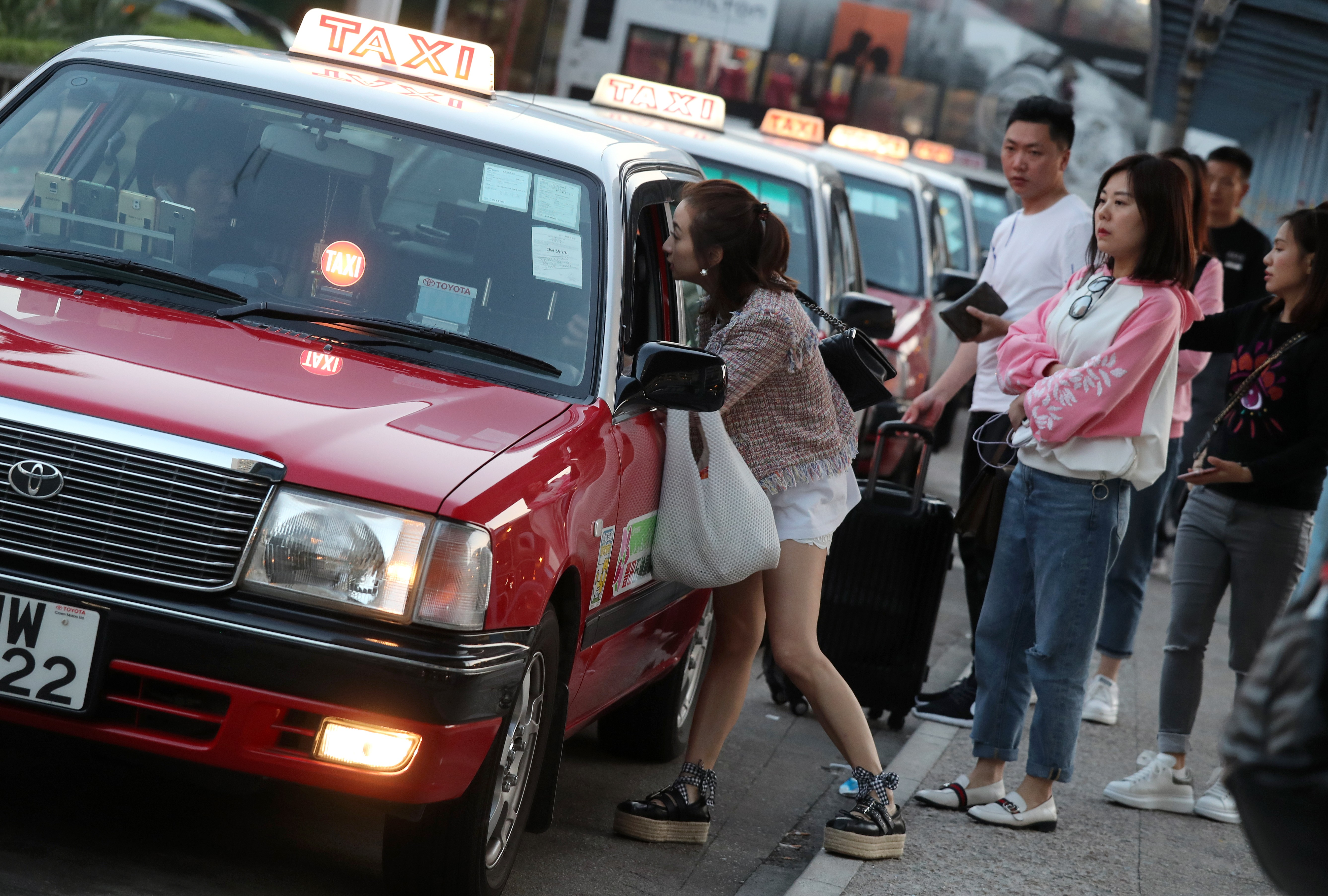 Faced with Uber challenge, Hong Kong taxis look to boost image and