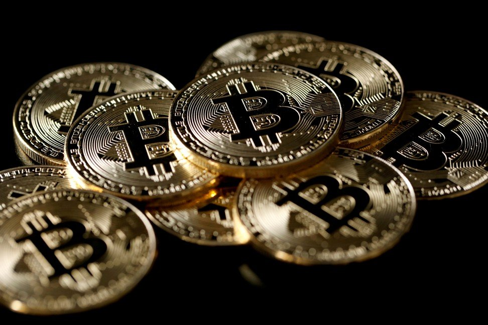 A collection of bitcoin tokens on December 8, 2017. Photo: REUTERS