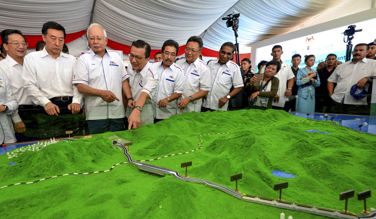 Mahathir Mohamad's predecessor as prime minister, Najib Razak, at the launch of the East Coast Rail Link project. Photo: AP