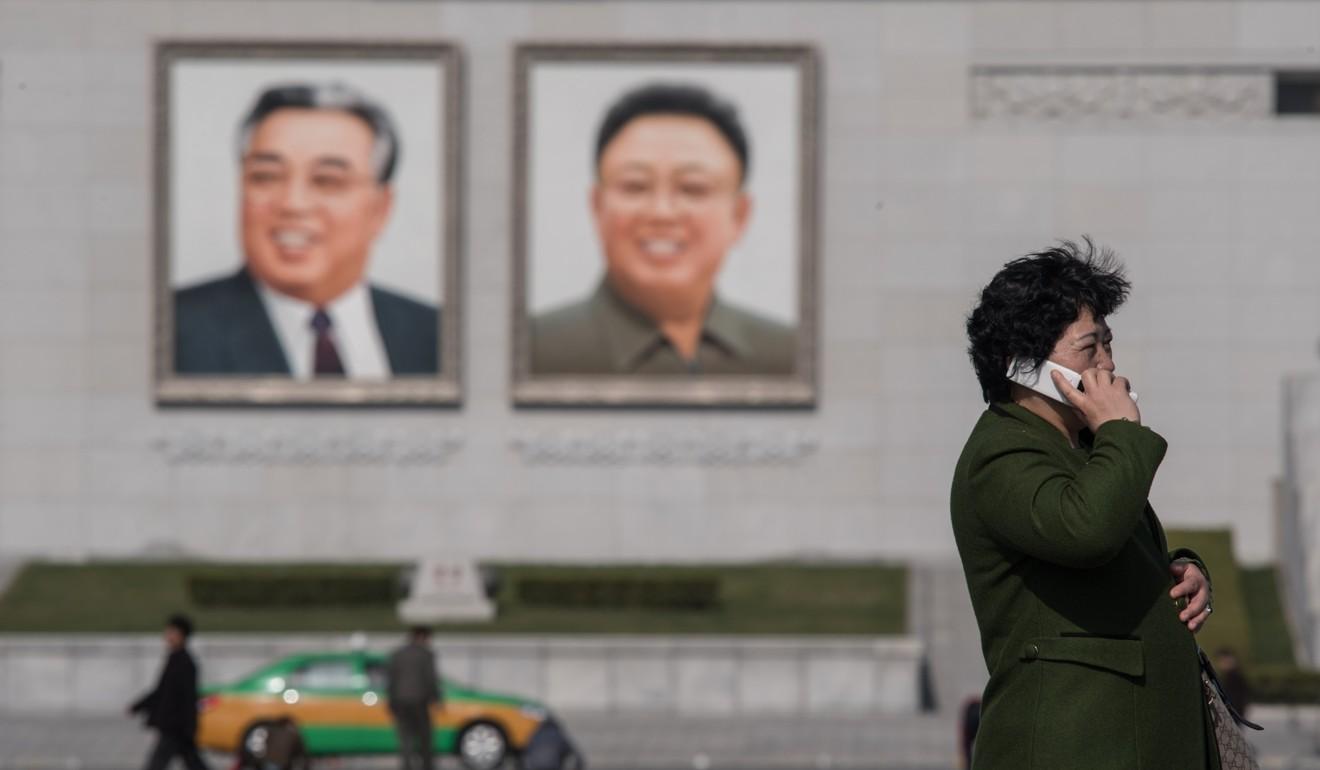 North Korean dissident smashes portraits of Kim Il-sung and Kim Jong