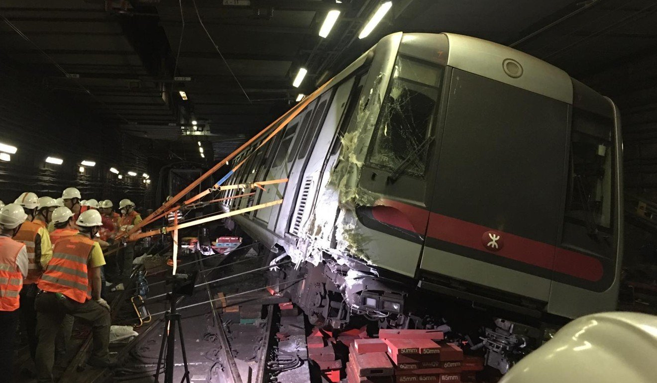 MTR staff working to get the derailed trail back upright. Photo: Handout