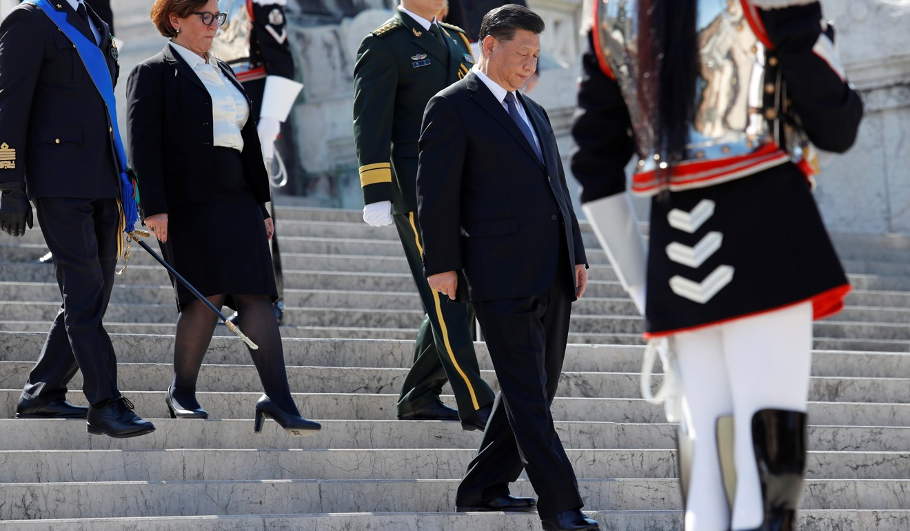 Xi Jinping attends a ceremony to pay his respects at the Tomb of the Unknown Soldier with Italian Defence Minister Elisabetta Trenta in Rome on Friday. Photo: Reuters