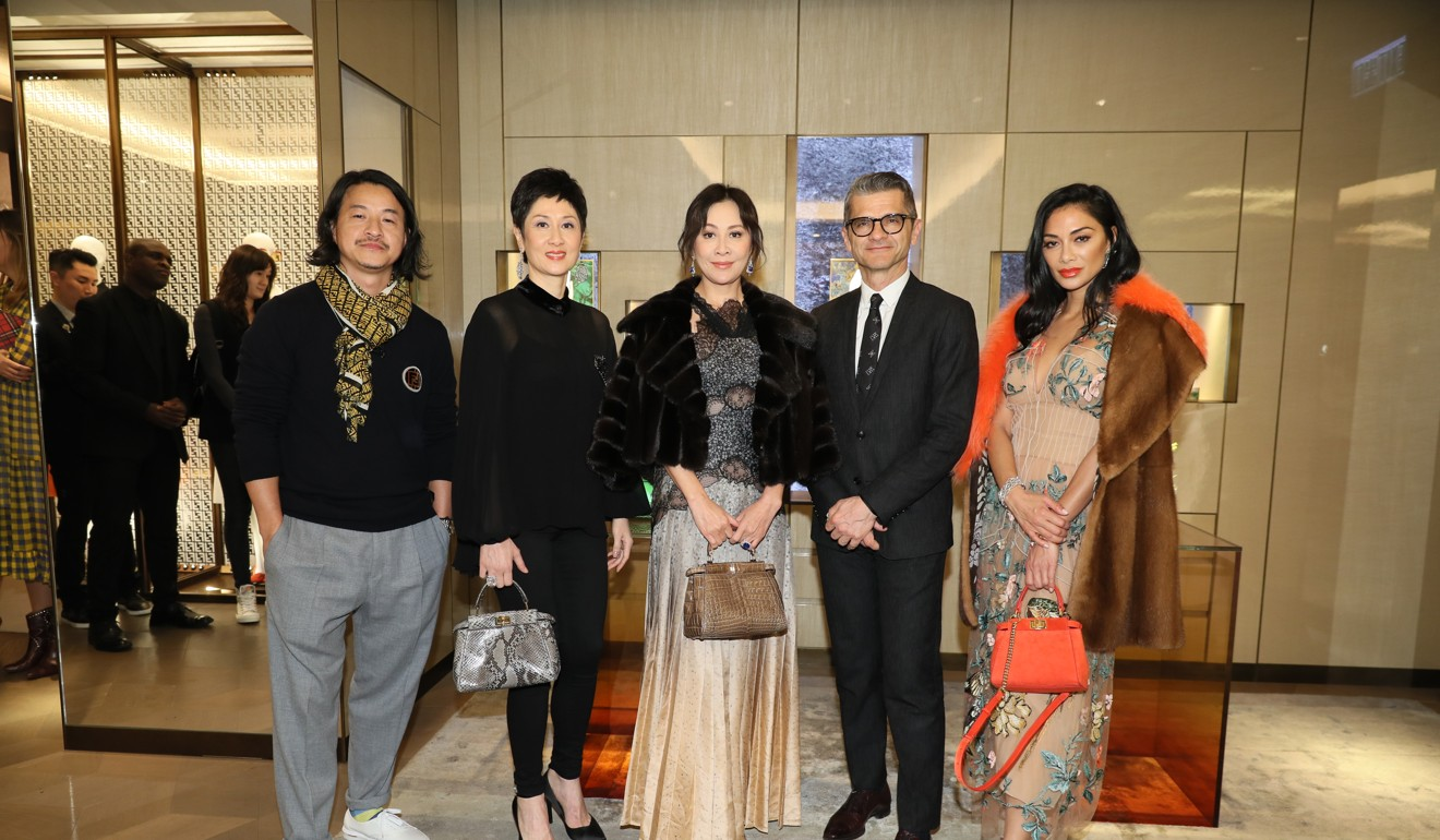 Artist Michael Lau, jeweller Michelle Ong, actress Carina Lau, Brunschwig and Scherzinger at a Fendi dinner hosted during Art Basel Hong Kong in March 2019.