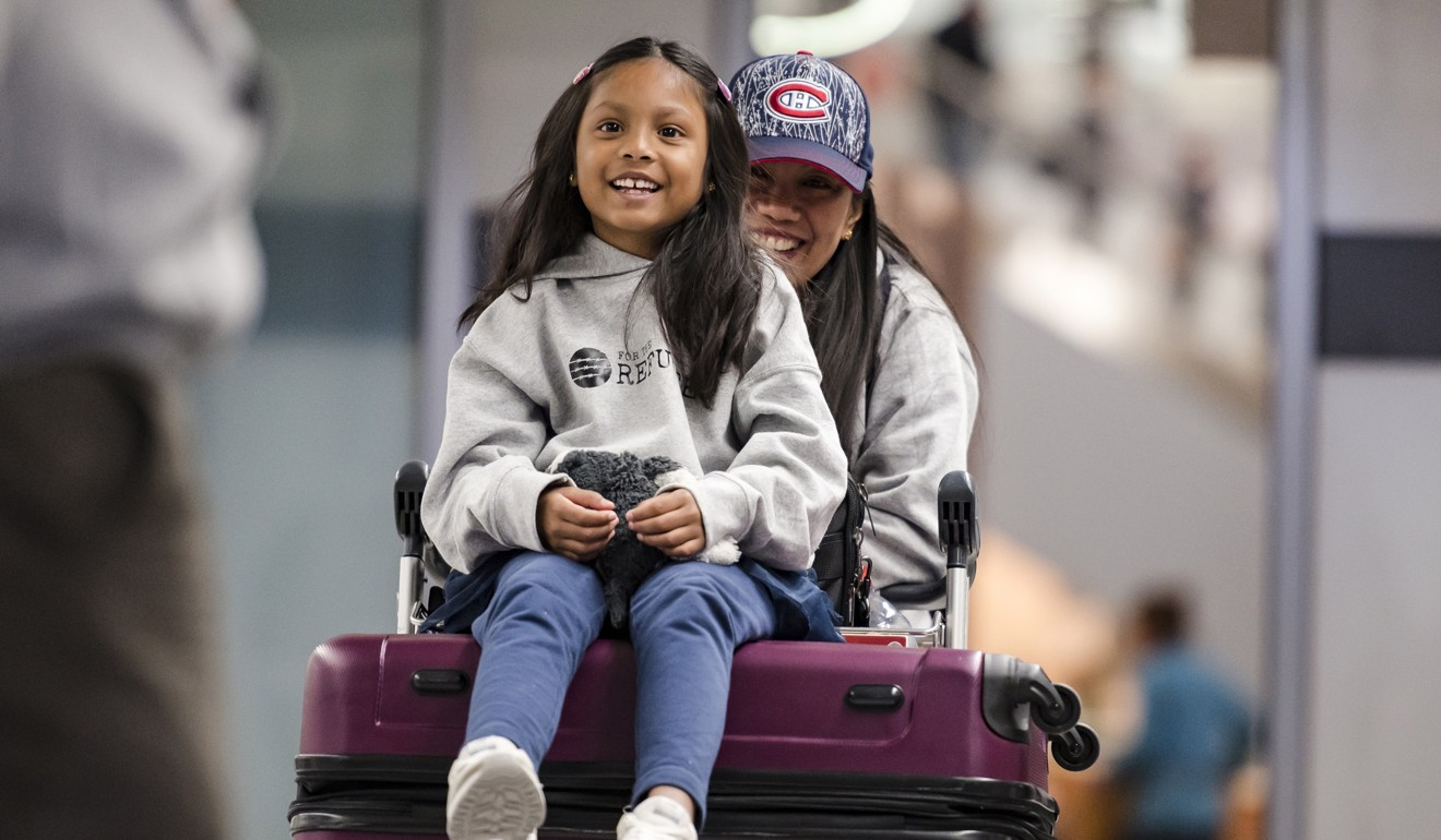 Vanessa Rodel and her seven-year-old daughter Keana talk to the media after arriving at Lester B. Pearson Airport in Toronto, on March 25. Photo: AP