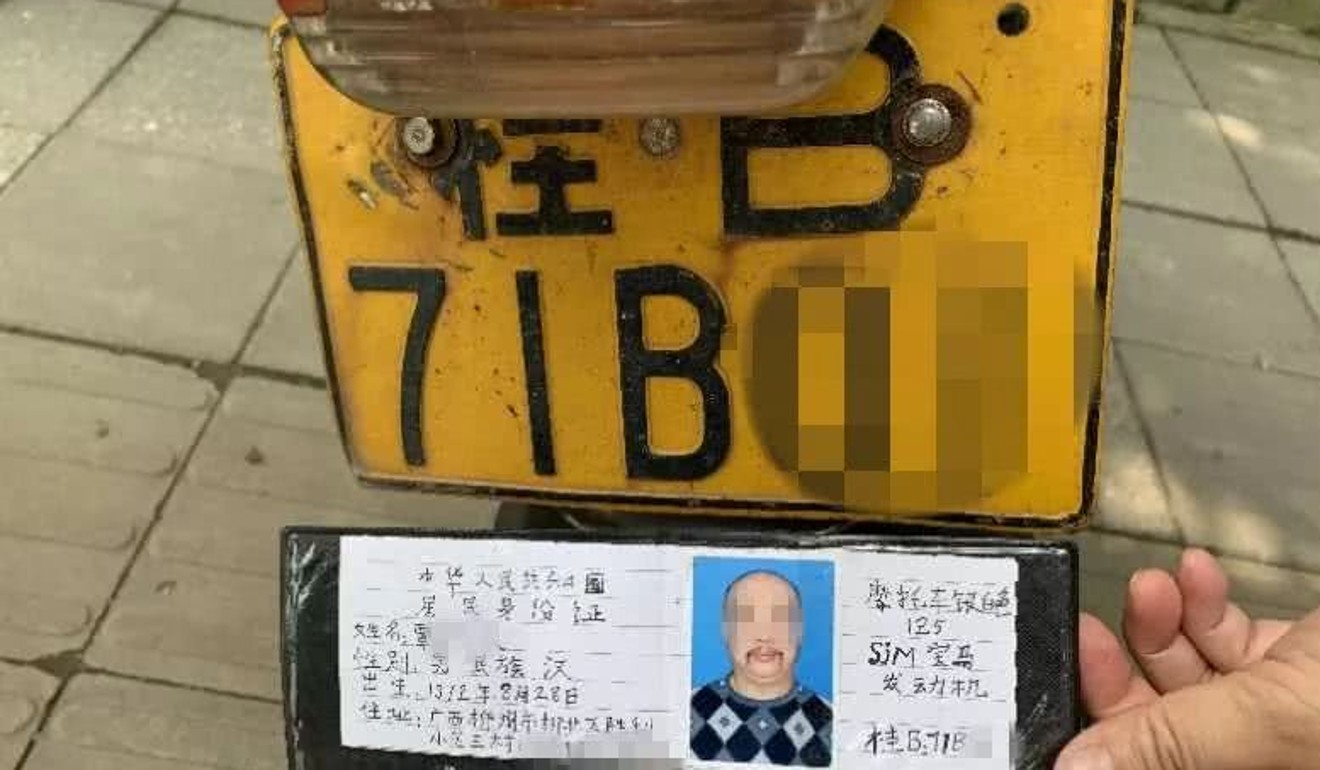 Police check the fake licence against the bike's number plate. Photo: Liuzhou Traffic Police