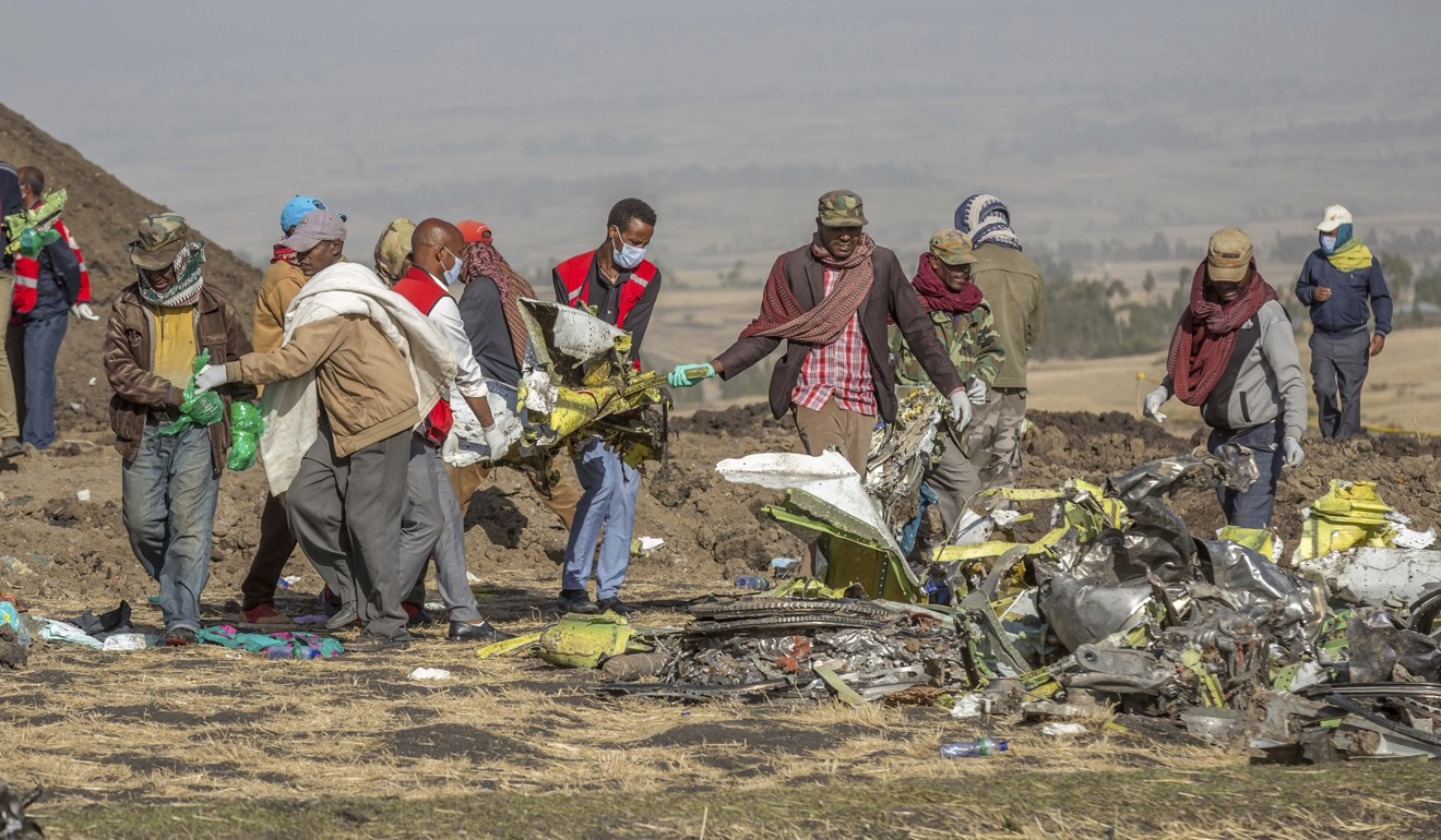 Rescuers at the scene of the Ethiopian Airlines crash. Photo: AP
