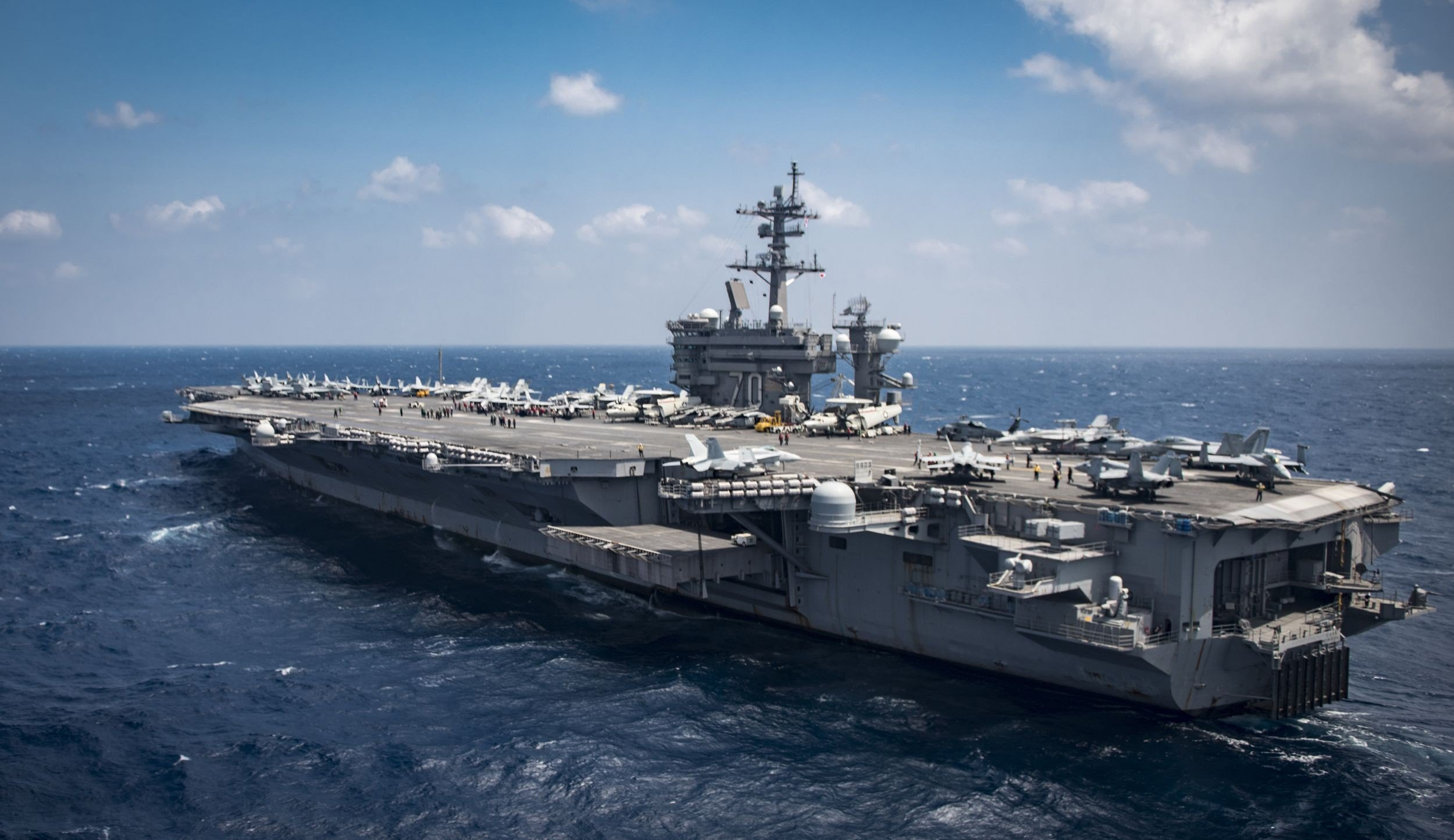 Image result for aircraft carrier covered in beach chairs