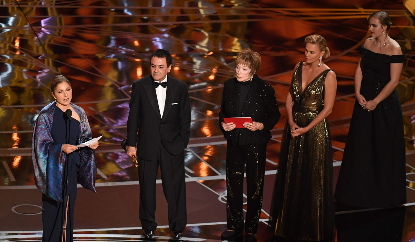 Iranian-US engineer Anousheh Ansari (left) delivers a speech on behalf of Asghar Farhadi after his film The Salesman won the Oscar for best foreign language film at the Academy Awards in 2017. Actresses Charlize Theron (second from right) and Shirley MacLaine (centre) look on. Photo: AFP