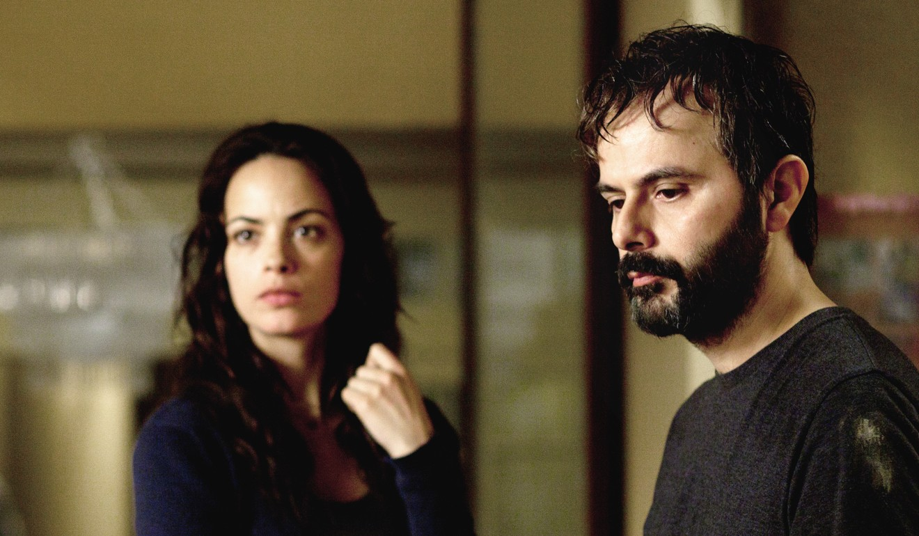 Berenice Bejo and Ali Mosaffa in a still from Farhadi's 2013 film, The Past. Photo: Handout
