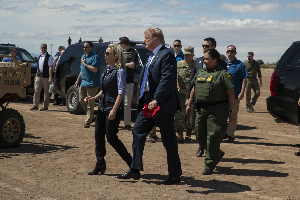 US President Donald Trump walks with Homeland Security Secretary Kirstjen Nielsen as they visit a newly refurbished part of a border wall with Mexico in Calexico, California, on Friday. Photo: AP