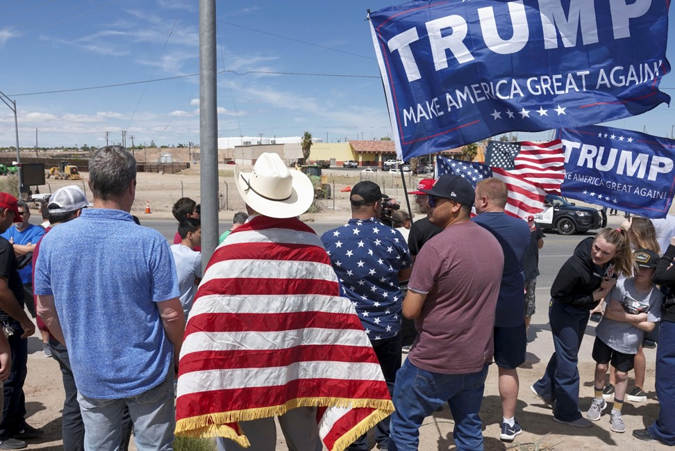 Supporters of US President Donald Trump stand near the US-Mexico border during a rally as Trump visits Calexico on Friday. Photo: Reuters