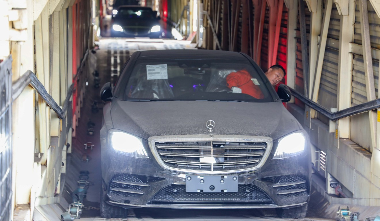A Mercedes-Benz car is unloaded from the carriage of a China-Europe freight train in Chongqing, southwest China. Photo: Xinhua