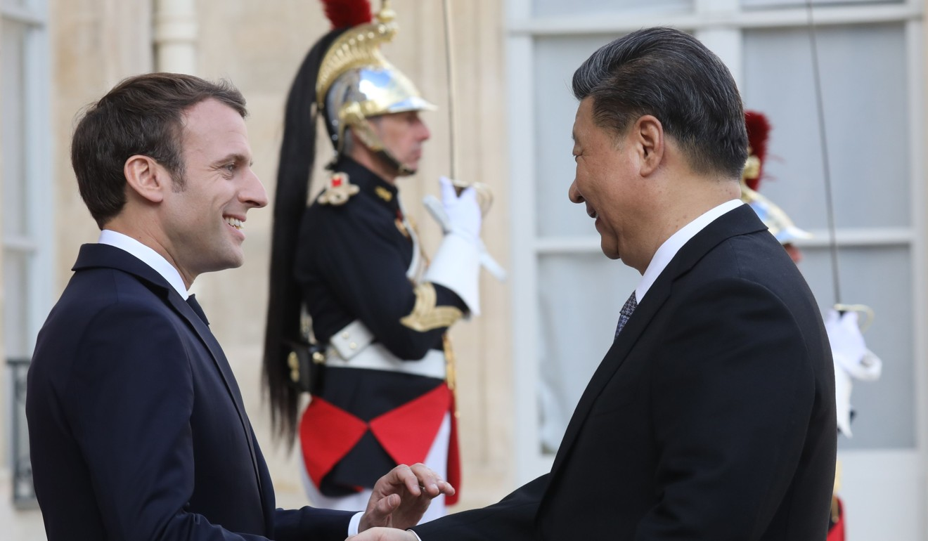 French President Emmanuel Macron welcomes Chinese President Xi Jinping to the Elysee Palace in Paris last month. Photo: AFP