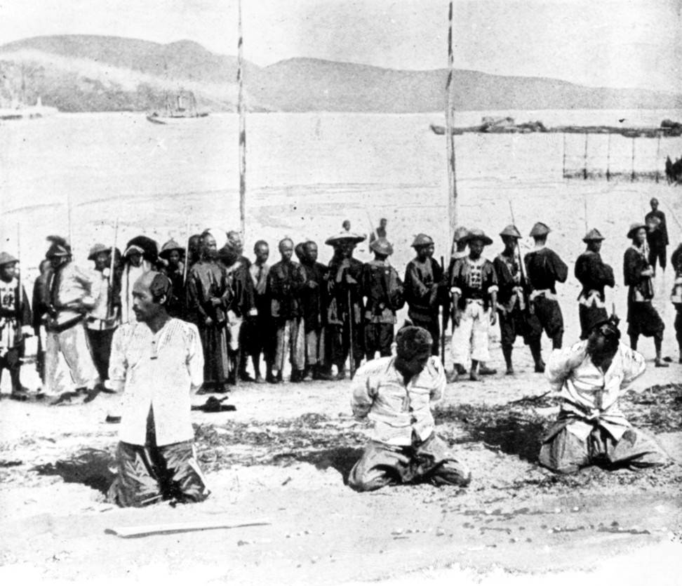 Chinese pirates charged with the hijacking of the SS Namoa off Hong Kong await execution in Kowloon in 1891.