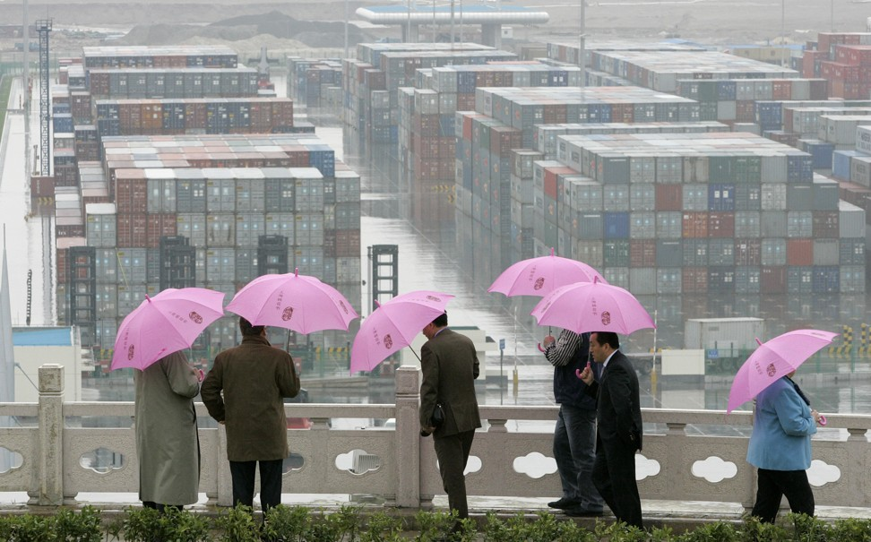 Visitors look at rows of containers at the Yangshan deep water port in Shanghai on April 6, 2006. Photo: AP