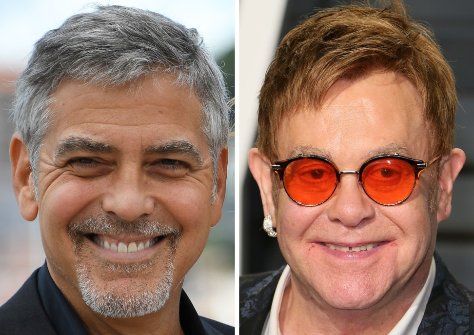 US actor George Clooney and British singer-songwriter Elton John. Photo: AFP