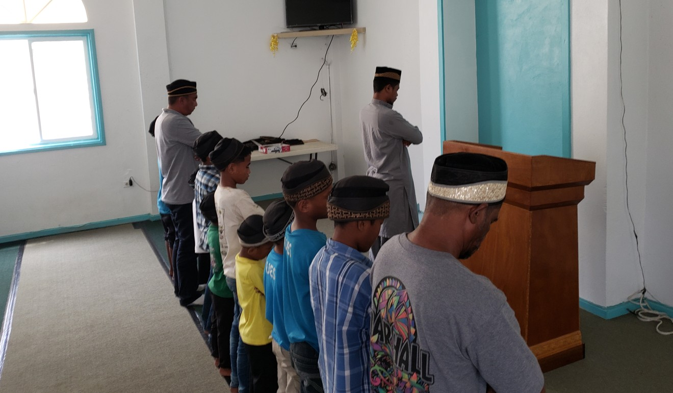 A prayer service at the Ahmadi mosque in the Marshall Islands. Photo: Sajid Iqbal