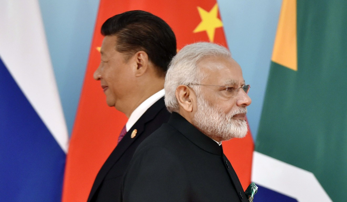 A summit between Xi Jinping (left) and Narendra Modi in Wuhan last year was seen as a breakthrough in China-India relations after the Doklam border dispute. Photo: AFP
